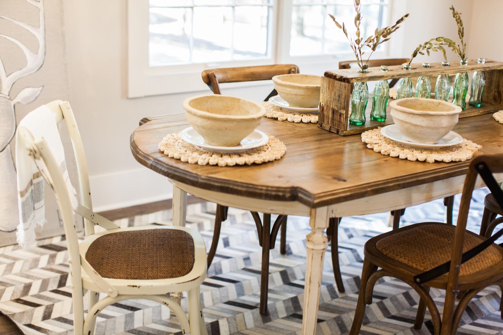 Custom Dining Table and Bottle Display: Junc2Funkt, Staging: Urban Farmhouse, Flooring: Tarkett, Lighting: Savoy House