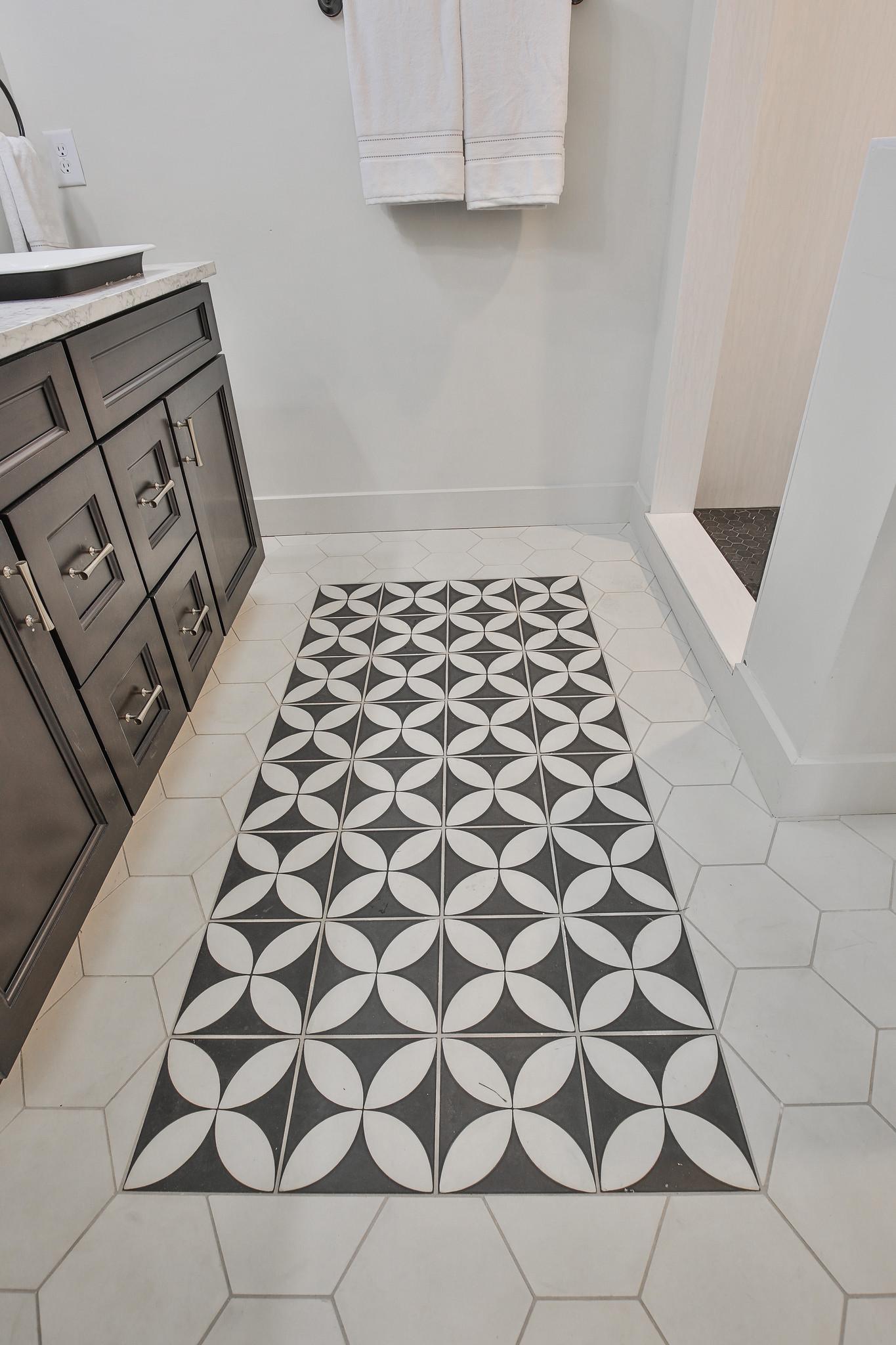 Sinks/Faucets/Shower Hardware: Kohler, Tile Floor: Cement Tile Shop, Shower surround and counters: Hanstone Quartz, Drawer Pulls: Liberty Hardware, Lighting: Savoy House, Vanity: Forevermark Cabinetry