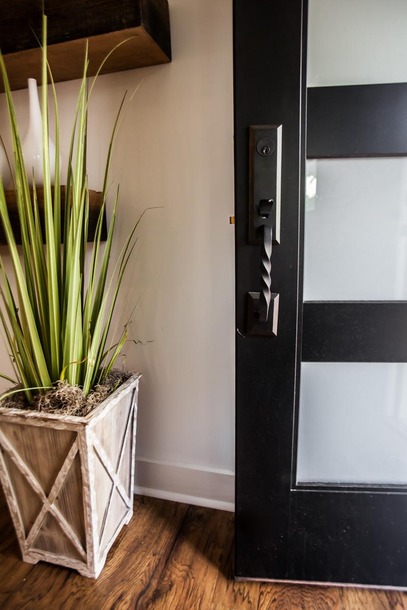 Flooring: Tarkett, Lighting: Savoy House, Cabinets: Forevermark Cabinetry, Sofa: Sofamania, Entry Handleset: Delaney Hardware