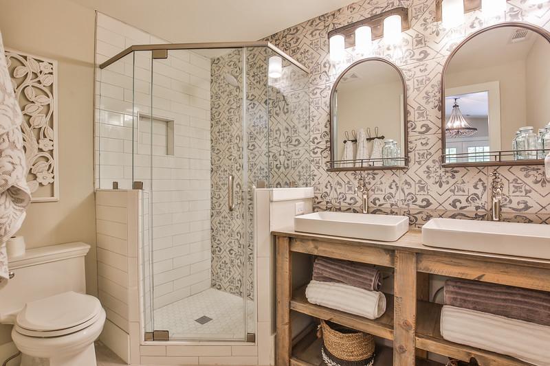 Sinks/Plumbing Hardware/Toilet: Kohler, Custom Vanity: Junc2Funkt, Lighting: Savoy House from Progressive Lighting