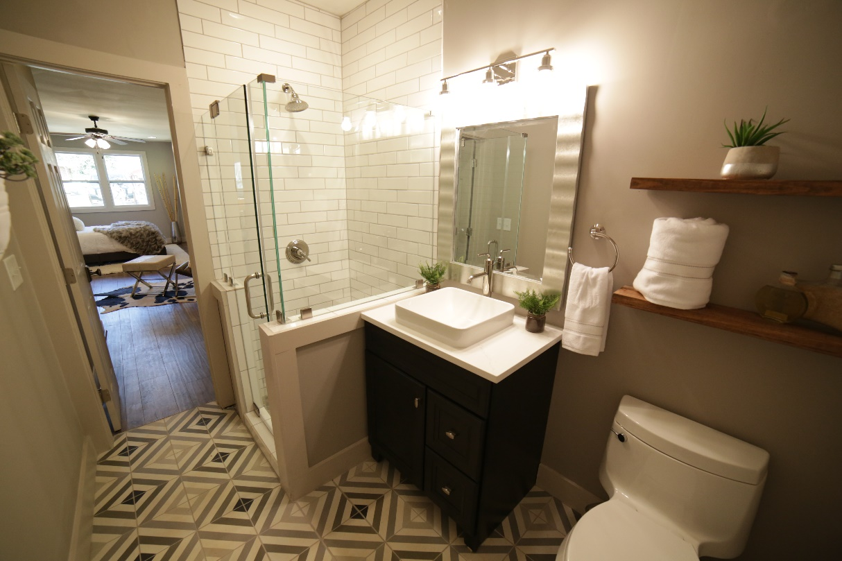 Plumbing Fixtures by Kohler, Vanity Cabinet by Forevermark, Tile by Cement Tile, Lighting by Progressive Savoy House Line