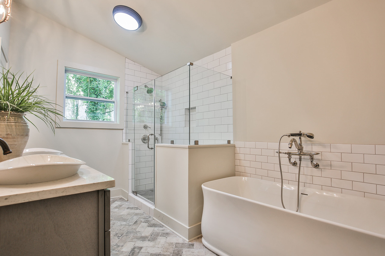 Lighting: Savoy House, Dresser: England Furniture, Vanity: Forevermark Cabinetry, Tub/Sinks/Plumbing Hardware: Kohler, Cabinet Pulls: Liberty Hardware, Bathroom Counter: Hanstone Quartz